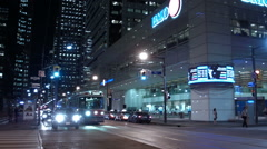 Streetcars & Traffic at night in the financial district - Toronto Canada Stock Footage