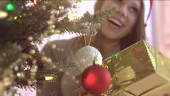 Beauty teen girl in santas hat opens Christmas gift box Stock Footage