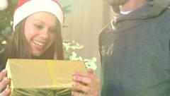 Young man surprising his girlfriend with a gift box Stock Footage