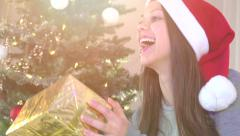 Beauty girl in santa hat getting a gift box - stock footage