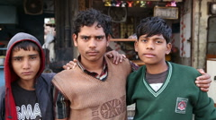 Portrait of three Indian boys standing with arms around each other. Stock Footage