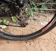 Patched up inner tube of an bicycle tire. Stock Photos