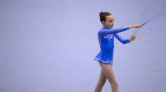 Young gymnast on rhythmic gymnastics tournament Stock Footage
