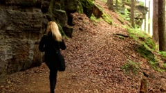 Girl walks through the forest in Saxon Switzerland Stock Footage