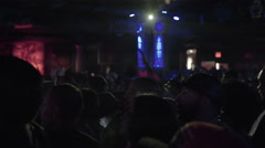Hip Hop crowd fans cheering at show, live rap music in club concert slow motion - stock footage