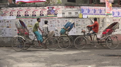 Cycle rickshaws riders take a break and read public newspapers in Dhaka Stock Footage