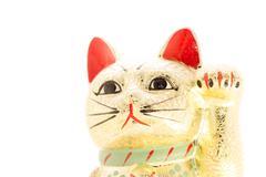 Golden beckoning cat also known as a Maneki neko Stock Photos