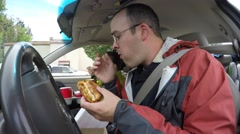 Timelapse family eating fast food in their car traveling Stock Footage
