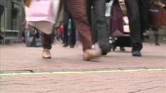 People's feet walking on busy London pavement Stock Footage