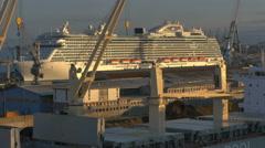 POV Passing cruise ship morning sun light cranes in dock - 4K UHD 0487 Stock Footage