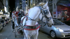 Horse drawn carriage Times Square night 42nd Street Manhattan NYC Stock Footage