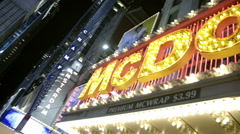 McDonalds Times Square with flashing lights marquee night Manhattan NYC - stock footage