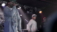 People cheering in slow motion; hip hop fans in audience at Mobb Deep rap show Stock Footage