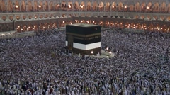 "Muslim pilgrims circling around the Kaaba "" Tawaf"" at Macca Stock Footage"