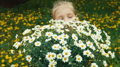 Closeup portrait child and large bouquet of white flowers Stock Footage