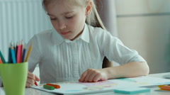 Closeup portrait child drawing a picture. Zooming Stock Footage