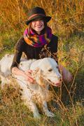 Girl with dog in park Stock Photos