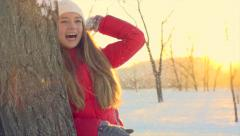 Young woman throwing a snowballs in winter park Stock Footage