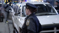 Attractive female police officer in uniform night slow motion Times Square NYC Stock Footage