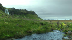 Wide View of Gray Day at the Seljalandsfoss Waterfall, ICELAND Stock Footage