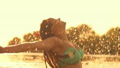 Beauty summer model girl splashing water in the river Stock Footage