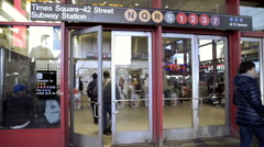 Times Square 42 Street subway station sign, exterior glass doors slow motion NYC Stock Footage