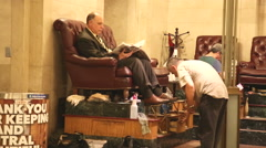 Shoe shiner on Grand Terminal Stock Footage