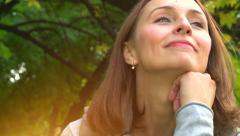 Beautiful middle aged woman in autumn park - stock footage