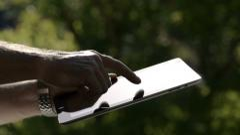 Close-Up Man Using IPad Outdoors - stock footage