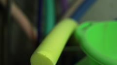 Pool floats in different colors, close up, shallow focus Stock Footage