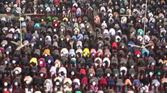 Muslim men attend Friday prayer in a mosque in Dhaka, Bangladesh - stock footage