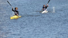 Young boys trying to win in canoe competition Stock Footage