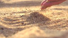 Sand falling through the woman's fingers Stock Footage