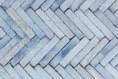Surface paved with bricks. Stock Photos