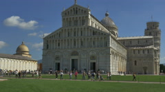 Tourists walking Piazza del Duomo Cathedral Pisa Italy leaning tower -4K UHD Stock Footage