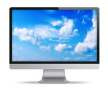 Computer display with blue sky and beautiful clouds on screen. - stock illustration