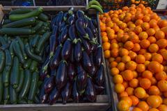 Expose for sale at a market stall, outdoors, with fruits and vegetables Stock Photos