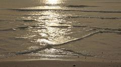 Sun light reflected on many sea  waves Stock Photos
