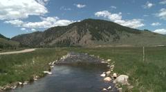 beautiful stream, river, creek, running through Colorado valley - stock footage