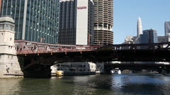 View from Chicago river passing by Clark Street bridge Stock Footage