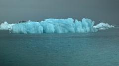 Stock Video Footage of Translucent Iceberg in Jökulsárlón Lagoon in ICELAND