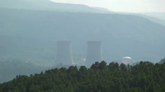 Nuclear power plant inside the river valley Stock Footage