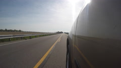 Vehicle traveling down country Road Camera Outside Stock Footage
