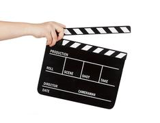 Human hand holding a movie clapboard Stock Photos