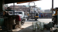 View on busy street with vehicles passing from a local street bar in Jodhpur. Stock Footage