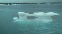 Icebergs floating in the Jökulsárlón Ice Lagoon in ICELAND Stock Footage