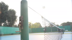 Dolly shot on tennis court in the morning Stock Footage