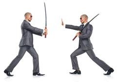 Two men figthing with the sword isolated on white Stock Photos
