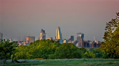 City. Cyclist and runner with London Skyline during sunset Stock Footage