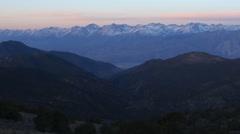 Time Lapse of Sunlight Shining over Alpine Mountain Range at Sunrise -Long Shot- - stock footage